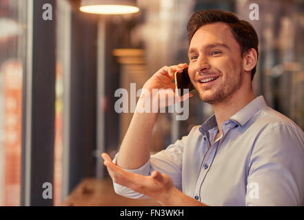 Man talking on mobile phone - Stock Photo