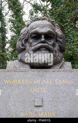 A large bronze bust marks the grave of the German political philosopher Karl Marx. Highgate cemetery, North London, - Stock Photo