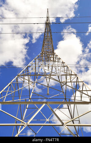 High tension power lines supported at the top of a tower provide reliable service to the suburban Chicago area. - Stock Photo