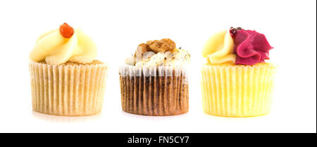 Three Cup Cakes In a row on a white background - Stock Photo