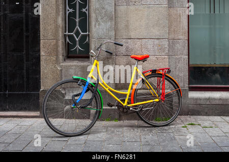 Colorful bicycle leaning against the wall in Amsterdam, Netherlands. - Stock Photo