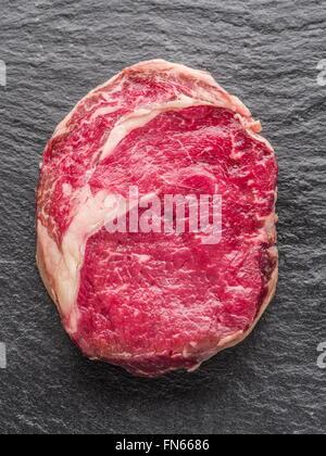 Steak Ribeye on the black graphite tray. - Stock Photo