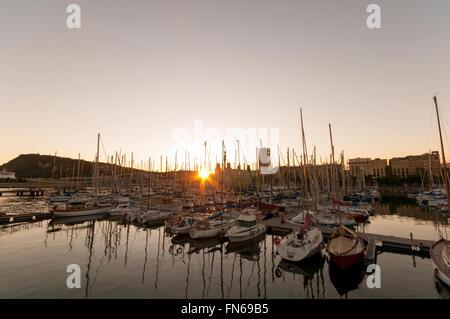 Barcelona, Spain - Oct 11 2011:Sunset over the  Marina Port Vell Barcelona , Spain. - Stock Photo