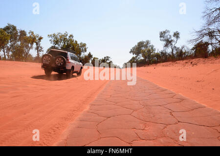 4X4 on Corrugated red dirt road to Cape Leveque, Dampier Peninsula, Kimberley Region, Outback, Western Australia, - Stock Photo