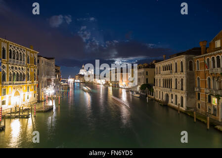 View from the Accademia Bridge over the Grand Canal and the Basilica Santa Maria della Salute in Venice at a full - Stock Photo