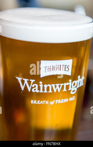 A pint of Wainwrights ale in a straight pint glass - Stock Photo