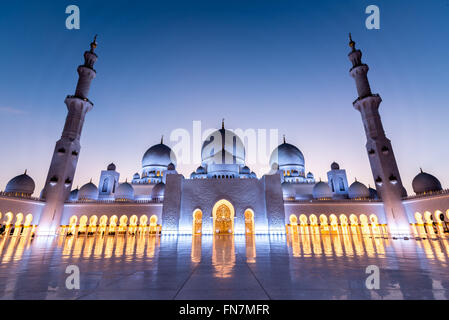 Courtyard of the Sheikh Zayed Grand Mosque in Abu Dhabi captured at sunset - Stock Photo