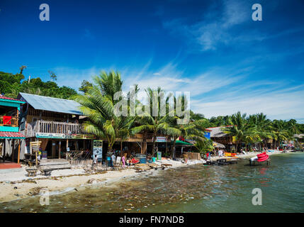 polluted dirty beach with garbage rubbish floating in sea on koh rong island cambodia - Stock Photo