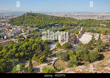Athens - The Odeon of Herodes Atticus or Herodeon under The Acropolis in morning light and the town panorama - Stock Photo