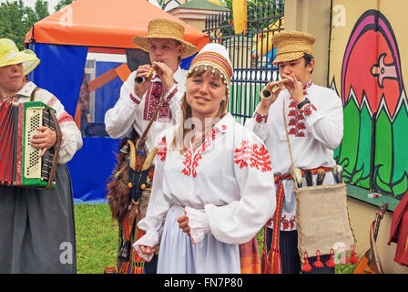 The folklore group dance and sing on street in Vitebsk. - Stock Photo