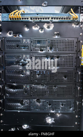 Hanover, Germany. 14th Mar, 2016. Bullet holes in a server rack at the exhibition booth of Link 11 are seen at the - Stock Photo