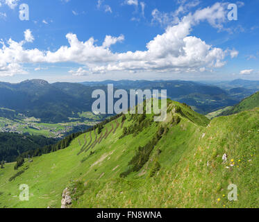 Allgau Alps - View of the valley Kleinwalsertal towards Riezlern, on the right the ridge trail over the Gehrenspitze - Stock Photo