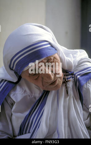 Mother Teresa in reflection at mother house in Kolkata, India during private moment with photographer - Stock Photo