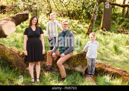 Portrait of a family sitting outdoors - Stock Photo