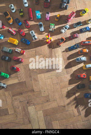 Overhead view of toy cars on the floor - Stock Photo