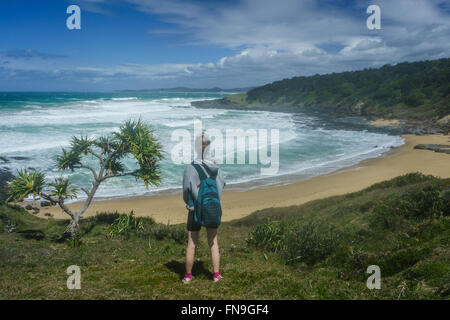 Woman looking at view, Wilson's Headland Walk, Yuraygir National Park, New South Wales, Australia - Stock Photo