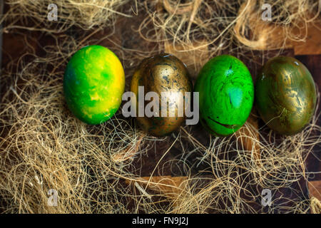 Green painted Easter eggs in a row - Stock Photo