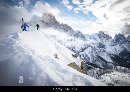 Two men Powder Skiing in Dolomites, Italy - Stock Photo