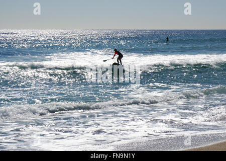 Stand up paddle surfing or standup paddleboarding - Stock Photo