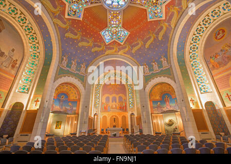 JERUSALEM, ISRAEL - MARCH 3, 2015: The main nave and modern cupola with the cross and mosaic in Church of St. Peter - Stock Photo