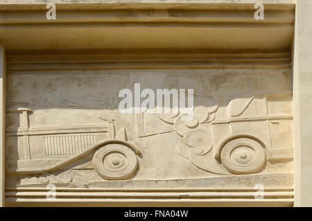 Façade 1920s Art Deco Garage Devoulx Bas-Relief or Carving of Vintage Cars & Exhaust Fumes Marseille or Marseiles - Stock Photo
