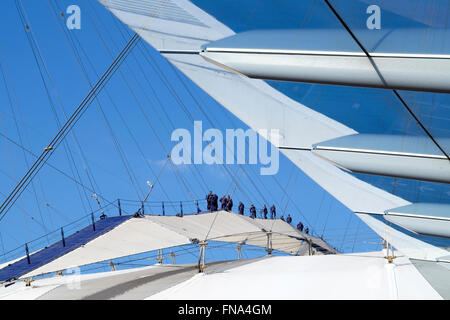 Tourists on the roof walk at the O2, Greenwich, London formerly known as the Millennium Dome. - Stock Photo