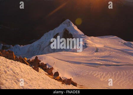 Glacier of Huayna Potosi seen from the summit at sunrise, Cordillera Real, Bolivia - Stock Photo