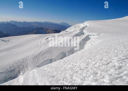 View from the glacier of Huayna Potosi over the Andes toward Illimani, Bolivia - Stock Photo