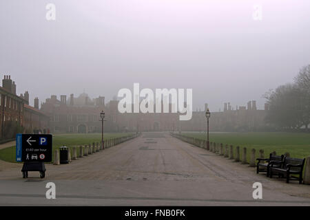 hampton court palace shrouded in fog, seen from main entrance - Stock Photo