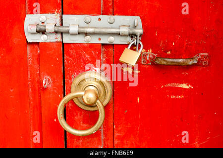 Red locked door with ring handle - Stock Photo