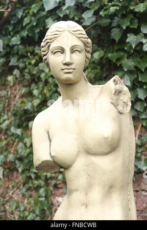 Copy of the famous Venus de Milo statue in a garden setting - Stock Photo