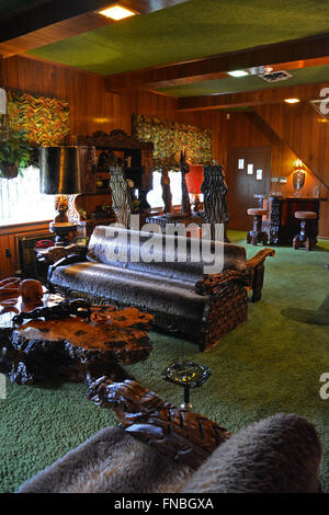 The jungle room at Graceland, Elvis Presley's home and now a museum in Memphis Tennessee. - Stock Photo