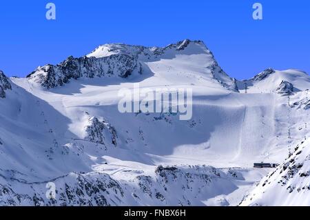 Ski lifts, runs and pistes on Rettenbach Glacier in Solden ski resort in Otztal Alps in Tirol, Austria - Stock Photo