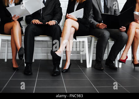 Group of business people waiting in waiting room - Stock Photo