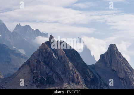 Les Pyramides Calcaires in Vallon de la Lex Blanche (Val Veny), with Aiguille Noire de Peuterey in the back, Italy - Stock Photo