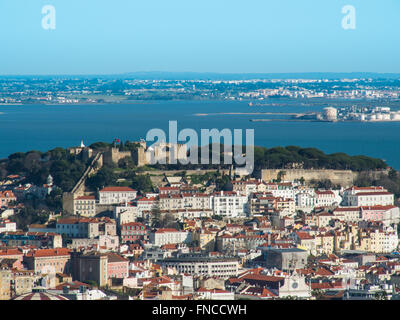 View of the city of Lisbon. Sao Jorge Castle and Alfama and Tagus River - Stock Photo