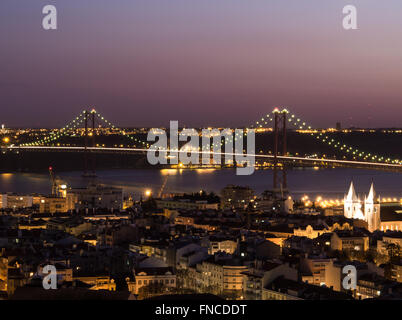 Ponte 25 de Abril at night view, Lisbon, Portugal - Stock Photo