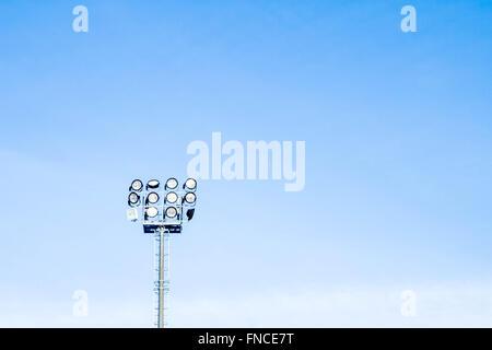 floodlights to illuminate the stadium - Stock Photo