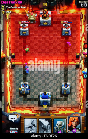 A match in the arena of Clash Royale, a mobile game developed by Supercell - Stock Photo
