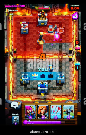 Winning a match in the arena of Clash Royale - Stock Photo
