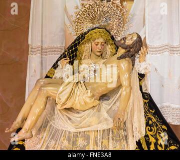 CORDOBA, SPAIN - MAY 26, 2015: The traditional vested Lady of Sorrow statue (Pieta) in church Iglesia de San Augustin, - Stock Photo