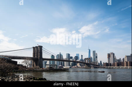 View from DUMBO, Brooklyn, across the East River towards the Brooklyn Bridge and downtown Manhattan skyline. - Stock Photo
