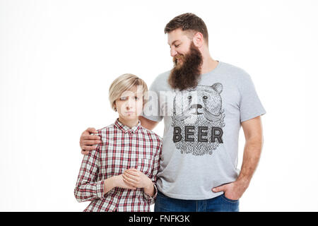 Happy handsome bearded father standing and hugging his daughter over white background - Stock Photo