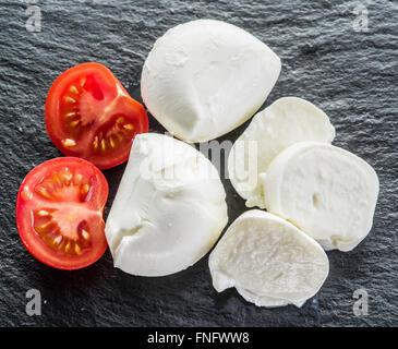 Mozzarella and tomatoes. Dark gray background. - Stock Photo