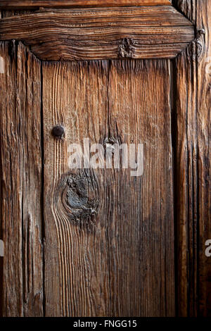 Ancient wooden door in the Medersa ben Youssef, Marrakech, Morocco - Stock Photo