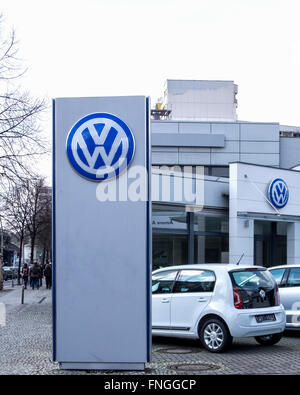 Volkswagen dealership exterior with cars and logo, Berlin - Stock Photo