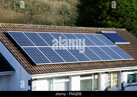 Solar panels on the roof of a bungalow in Cornwall, England, UK - Stock Photo