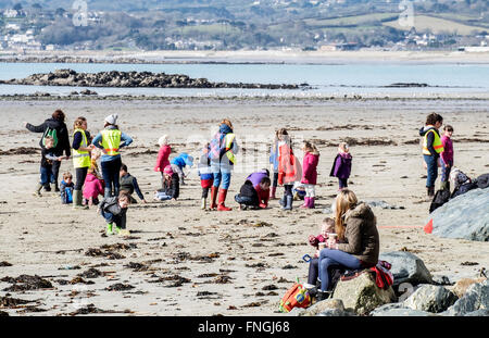 A primary school having lessons on the beach at Marazion in Cornwall, UK - Stock Photo