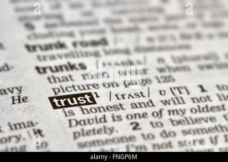 Trust Word Definition Text in Dictionary Page - Stock Photo