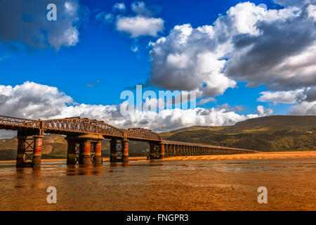 Landscape of Barmouth Bridge in North Wales, UK at low tide. - Stock Photo
